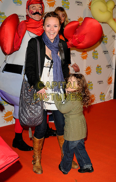 "CHARLIE BROOKS & GUEST.At the ""Spongebob Squarepants - The Sponge who could Fly"" Gala performance at the Hammersmith Apollo, London, England. .March 5th 2009 .full length black leather jacket brown boots grey gray bag purse green blue scarf white kid child.CAP/CAN.©Can Nguyen/Capital Pictures."