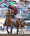Jeremy Buhler competes in the team roping event at the Reno Rodeo in Reno, Nev., on Thursday, June 27, 2013.<br /> Photo by Cathleen Allison