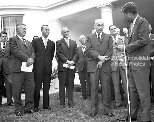 United States President John F. Kennedy presents Dr. Robert R. Gilruth Director of the Manned Spacecraft Center, Houston, Texas with the Medal for Distinguished Federal Civil Service. The ceremony took place on the White House Lawn on August 1, 1962. In attendance were second from left to right: Astronaut, Alan Shepard Astronaut, John Glenn Dr. Robert R. Gilruth NASA Administrator, James Webb President John F. Kennedy..Credit: NASA via CNP