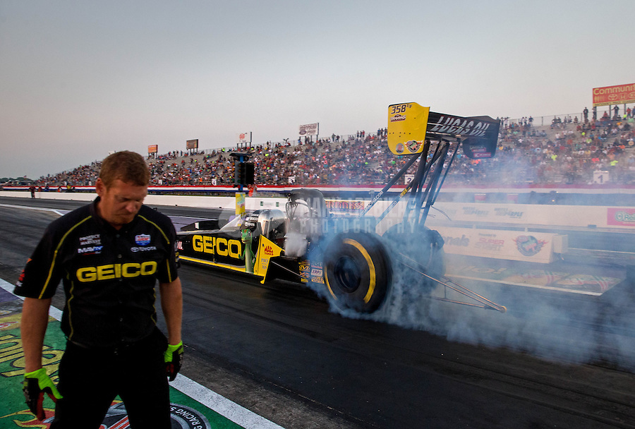 Apr 25, 2014; Baytown, TX, USA; A crew member for NHRA top fuel dragster driver Richie Crampton during qualifying for the Spring Nationals at Royal Purple Raceway. Mandatory Credit: Mark J. Rebilas-