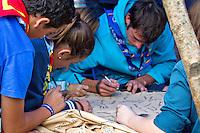 Visitors writing their names to leather blanket. Photo: Mikko Roininen / Scouterna