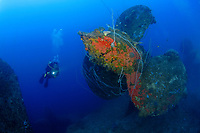 shipewreck with silhouette of scuba diver behind, One of four huge propellors on HIJMS Nagato Bikini Atoll, Marshall Islands, Micronesia, Pacific Ocean