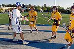 Rancho Santa Margarita, CA 04/30/10 - Trevor Cook (Santa Margarita #5), Sean Doyle (Torrey Pines #4), Max Myrick (Torrey Pines #9) in action during the Rancho Santa Margarita CHS-Torrey Pines boys varsity lacrosse game.