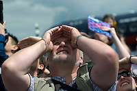 People watching the flying display at the Farnborough International Airshow .