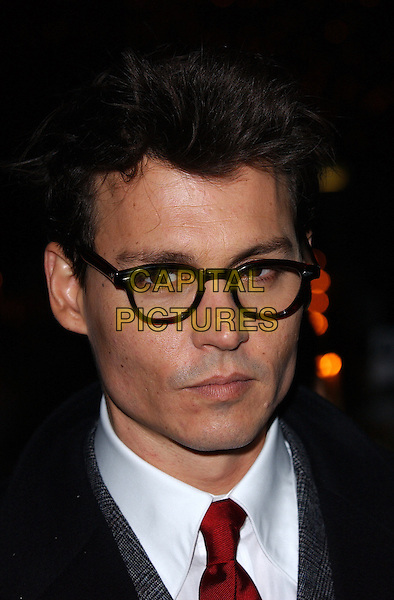 "JOHNNY DEPP.""Finding Neverland"" UK charity premiere.Odeon, Leicester Square.London 17 October 2004.Ref: FIN.portrait headshot black glasses.www.capitalpictures.com.sales@capitalpictures.com.©Steve Finn/Capital Pictures ."