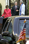 "United States President George W. Bush (C) and First Lady Laura Bush (L) speak with Rev. Luis Leon after attend church at St. John's Church December 11, 2005 in Washington, DC. St. John's is also known as ""The President's Church"" because it is directly across Lafayette Park from the White House. <br /> Credit: Chip Somodevilla / Pool via CNP<br /> <br /> Pool Report #1 - 12/11/05 -- Your poolers arose with the songbirds and barely had time to hit Starbucks before the motorcade was rolling. By 7:40 am, Potus and Mrs. Bush were in their car, on the way to St. John's Church, where they sat on the left side of the center aisle, about three rows back. Robert Mueller was across the aisle.  Rev. Luis Leon gave the sermon, talking about the important of not compartmentalizing faith by simply attending church and following ritual.  ""We have to experience God, we don't want to create a box around'' religion he said. He veered into the political by discussing the ""checklists'' some apply to faith, with questions such as ""Are you for same-sex marriage or not.'' That drew laughter; from where we were sitting in the back we could not see if either the President or Mrs. Bush joined in the laughter. He discussed emails he received, including one from someone who asked ""How dare you preach in front of the President,'' and apparently assuming that because Rev. Leon was born in Guantanamo he was a follower of ideologies the president should not be hearing about.   ""Well, hello, I'm rector of the church,'' he said with a laugh.  He concluded with: ""Expect the unexpected. God offers maximum support but minimum protection.''  The pool got a brief wave from POTUS as he exited the church, then we did the world's shortest motorcade in reverse. Within 10 minutes we were rolling again, to Quantico. We stopped at traffic signals on 15th street, as inconspicuous as you can be in a 14 or 15-car motorcade can be with black-suited agents sitting in traffic with their automatic weapons. Once on the highway, other dr"