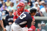 Alex Rodriguez (13) collides with Philadelphia Phillies catcher Cameron Rupp (29) during a Spring Training game against the New York Yankees on March 27, 2015 at Bright House Field in Clearwater, Florida.  New York defeated Philadelphia 10-0.  (Mike Janes/Four Seam Images)