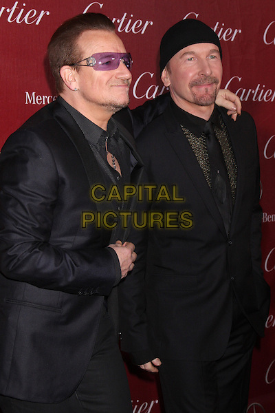 PALM SPRINGS, CA - January 04: Bono, The Edge at the 25th Annual Palm Springs International Film Festival, Palm Springs Convention Center, Palm Springs,  January 04, 2014. <br /> CAP/MPI/JO<br /> &copy;Janice Ogata/MPI/Capital Pictures