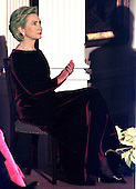 """First lady Hillary Rodham Clinton listens to the President's remarks during a presentation in the East Room of the White House in Washington, D.C. in honor of the """"1998 Kennedy Center Honors"""" recipients on December 6, 1998..Credit: Ron Sachs - CNP"""