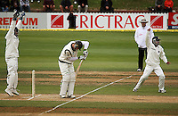 Indian captain MS Dhoni (left) and Gautam Gambhir appeal for lbw on James Franklin during day four of the 3rd test between the New Zealand Black Caps and India at Allied Prime Basin Reserve, Wellington, New Zealand on Monday, 6 April 2009. Photo: Dave Lintott / lintottphoto.co.nz.