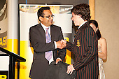 Joshua Andrew receives the UNITEC School of Sport Study grant from Manoj Daji. ASB College Sport Young Sportsperson of the Year Awards held at Eden Park, Auckland, on November 11th 2010.
