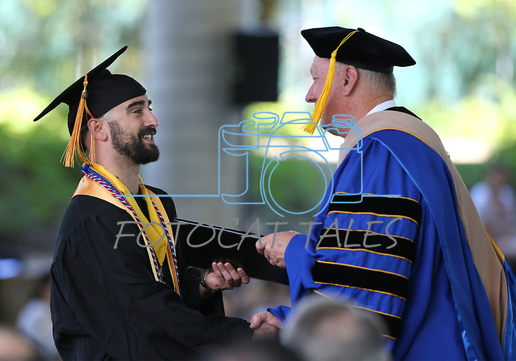Alex James, of Carson City, receives his diploma during the Western Nevada College 2017 Commencement in Carson City, Nev. on Monday, May 22, 2017.  <br />