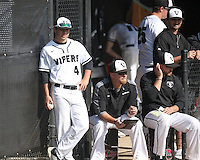 Vandegrift senior Garrett Jones (4) and coach Allen McGee (center).