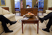 NSC staff members sit in the Oval Office while President Obama speaks to foreign leaders 1/27/09. .Mandatory Credit: Pete Souza - White House via CNP
