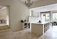 In the large and spacious kitchen the central island, sink unit and floor have all been constructed from polished concrete