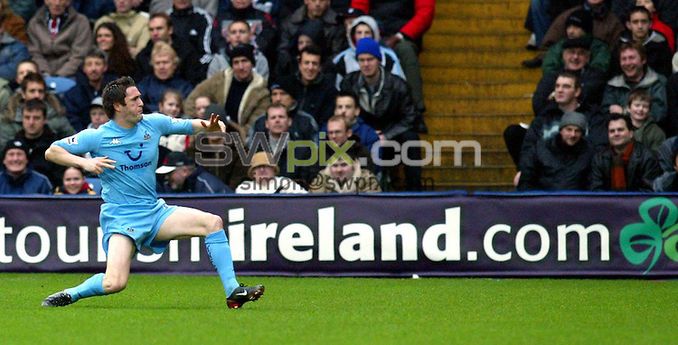 Pix: Rob Matthews/SWpix.com. Soccer. Barclaycard Premiership. Season 2003/2004. Fulham v Tottenham 31/1/2004...COPYWRIGHT PICTURE>>SIMON WILKINSON>>01943 608782>>..Robbie Keane, the Tottenham and Ireland striker, celebrates after scoring...
