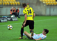 Wellington's Alex Rufer and Adelaide's Jordan O'Doherty compete for the ball during the A-League football match between Wellington Phoenix and Adelaide United at Westpac Stadium in Wellington, New Zealand on Saturday, 27 January 2018. Photo: Dave Lintott / lintottphoto.co.nz