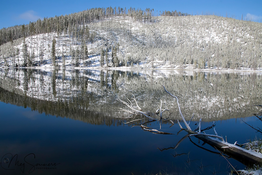 Spring snow melts quickly at North Twin Lake, Yellowstone National Park.