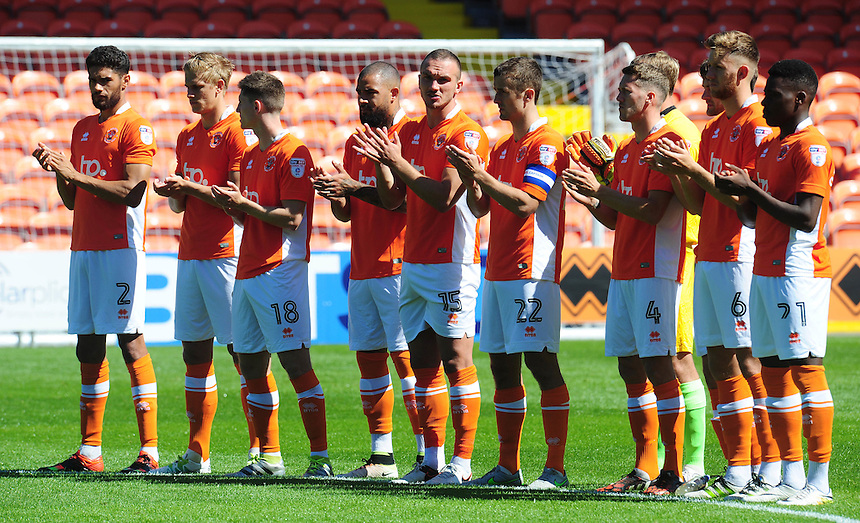 Blackpool players observe a mintues applause in memory of former player Russell Coughlin<br /> <br /> Photographer Kevin Barnes/CameraSport<br /> <br /> Football - The EFL Sky Bet League Two - Blackpool v Exeter City - Saturday 6th August 2016 - Bloomfield Road - Blackpool<br /> <br /> World Copyright &copy; 2016 CameraSport. All rights reserved. 43 Linden Ave. Countesthorpe. Leicester. England. LE8 5PG - Tel: +44 (0) 116 277 4147 - admin@camerasport.com - www.camerasport.com