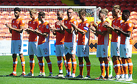Blackpool players observe a mintues applause in memory of former player Russell Coughlin<br /> <br /> Photographer Kevin Barnes/CameraSport<br /> <br /> Football - The EFL Sky Bet League Two - Blackpool v Exeter City - Saturday 6th August 2016 - Bloomfield Road - Blackpool<br /> <br /> World Copyright © 2016 CameraSport. All rights reserved. 43 Linden Ave. Countesthorpe. Leicester. England. LE8 5PG - Tel: +44 (0) 116 277 4147 - admin@camerasport.com - www.camerasport.com