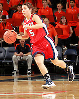 CHARLOTTESVILLE, VA- December 7: Reagan Miller #5 of the Liberty Lady Flames handles the ball during the game against the Virginia Cavaliers on December 7, 2011 at the John Paul Jones arena in Charlottesville, Va. Virginia defeated Liberty 64-38. (Photo by Andrew Shurtleff/Getty Images) *** Local Caption ***