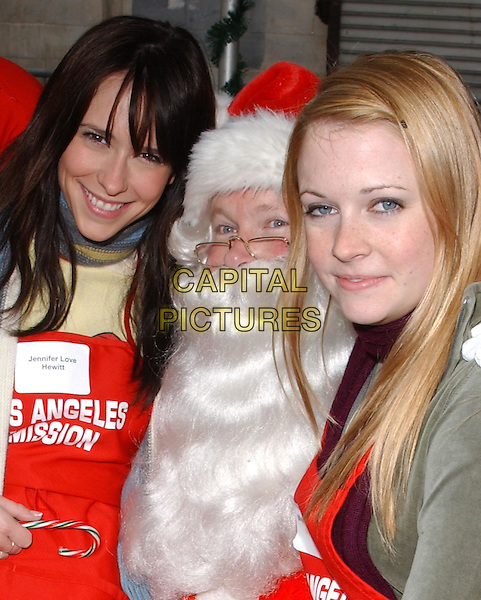 MELISSA JOAN HART & JENNIFER LOVE HEWITT.volunteer as The Los Angeles Mission Serve Up Holiday Cheer for the Homeless of Skid Row in Downtown Los Angeles, California on Christmas Eve .24 December 2003  .**UK Sales Only**      .father christmas, xmas, santa  claus .www.capitalpictures.com.sales@capitalpictures.com.©Capital Pictures.
