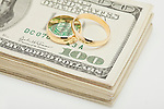 Wedding ring son bunch of dollar banknotes, studio shot