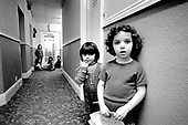 Kosovan children play in the corridor of a Bayswater hotel used to house homeless families by Westminster City Council
