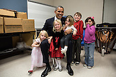 "Dec. 16, 2012.""Two days after the shootings at Newtown, the President traveled to Connecticut to meet with the victims families and give remarks at a prayer vigil. The President spent hours greeting family members. Difficult as that was for everyone, the one moment that helped sooth the pain was when he posed for a photo with the siblings and cousins of Emilie Parker, one of the 20 children who died that day in Newtown. I see both sadness and hope in this photograph, and I know after a lot of tears that day, it meant so much to the President that everyone was able to smile for a moment in this family photo. Thanks to the Parker family for allowing us to show this photograph publicly."" .Mandatory Credit: Pete Souza - White House via CNP"