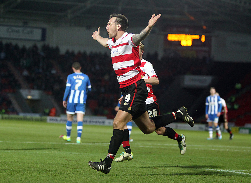 Doncaster Rovers' Chris Brown celebrates scoring his sides third goal from the penalty spot<br /> <br /> Photo by Rich Linley/CameraSport<br /> <br /> Football - The Football League Sky Bet Championship - Doncaster Rovers v Wigan Athletic - Saturday 18th January 2014 - Keepmoat Stadium - Doncaster<br /> <br /> &copy; CameraSport - 43 Linden Ave. Countesthorpe. Leicester. England. LE8 5PG - Tel: +44 (0) 116 277 4147 - admin@camerasport.com - www.camerasport.com