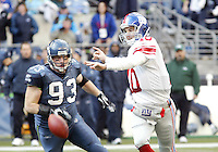 Seattle Seahawks defensive tackle #03 Craig Terrill races towards the ball after New York Giants quarterback Eli Manning fumbled it away during the second quarter at Quest Field in Seattle, WA. at Quest Field in Seattle, WA. Mandatory photo credit - Jesse Beals