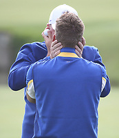 Thomas Bjorn (Team Europe Captain) hugs Ian Poulter (Team Europe) during Sunday's Singles, at the Ryder Cup, Le Golf National, Île-de-France, France. 30/09/2018.<br /> Picture David Lloyd / Golffile.ie<br /> <br /> All photo usage must carry mandatory copyright credit (© Golffile | David Lloyd)