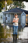 USA, Illinois, Chillicothe, Girl (8-9) carrying teddy bear and standing in water
