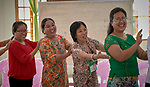 Participants give each other backrubs during an ecumenical workshop on women's empowerment in Kalay, Myanmar. The workshop was sponsored by the Women's Department of the Myanmar Council of Churches and led by Emma Cantor (second from right), a regional missionary for United Methodist Women.