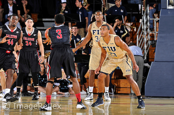 14 November 2013:  FIU guard Marco Porcher Jimenez (23) and center Joey De La Rosa (34) defend in the second half as the FIU Golden Panthers defeated the Florida College Falcons, 85-39, at the U.S. Century Bank Arena in Miami, Florida.