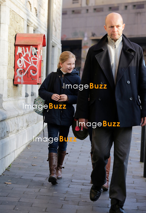 PRINCESS ELISABETH OF BELGIUM LEAVING SCHOOL WHILE BEING THREATENED WITH KIDNAPPING - Princess Elisabeth, the 12-year-old daughter of Belgium's new king, King Philippe and Queen Mathilde has been threatened with kidnapping, local media reported on Tuesday December 3rd, 2013.<br /> An anonymous letter sent to the newspaper, 'La Derniere Heure,' and addressed to King Philippe contained the threat, along with racist remarks with neo-Nazi overtones, the daily reported.<br /> &quot;I am going to abduct Princess Elisabeth. This is not a joke,&quot; the newspaper quoted the letter as saying.<br /> The publication said it had notified the police and the royal palace. It said police officers had been deployed outside Elisabeth's school. Belgium, Brussels, December 3, 2013.