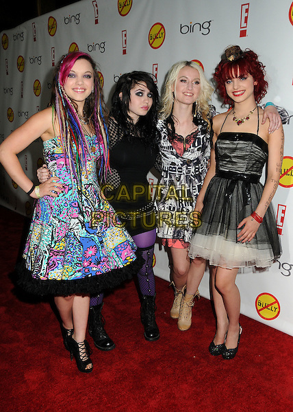"Cherri Bomb.""Bully"" Los Angeles Premiere held at Grauman's Chinese 6 Theatre, Hollywood, California, USA..March 26th, 2012.full length dress blue yellow green black white floral print dress tulle white hand on hip band group.CAP/ADM/BP.©Byron Purvis/AdMedia/Capital Pictures."