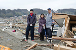 Hiroshi Tsuda (53) and his wife Seiko (46) and son Naoki (15) stand outsode what was once their home  in Rikuzentakata, Iwate Prefecture, Japan on March 21, 2011..Photographer: Rob Gilhooly