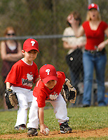 Children play baseball with the support of family members during Warwick Township Little League opening day for the baseball season April 12, 2008 in Warwick, Pennsylvania. (Photo by William Thomas Cain/Cain Images)