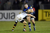 Henry Thomas of Bath Rugby is tackled in possession. Aviva Premiership match, between Bath Rugby and Wasps on December 29, 2017 at the Recreation Ground in Bath, England. Photo by: Patrick Khachfe / Onside Images