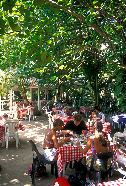 People at Le Karacoli restaurant, Grande Anse, town of Deshaies, Basse Terre, Guadeloupe, French West Indies