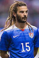 United States' midfielder Kyle Beckerman (15) during the singing of national anthem before an international friendly at the Alamodome, Wednesday, April 15, 2015 in San Antonio, Tex. (Mo Khursheed/TFV Media via AP Images)