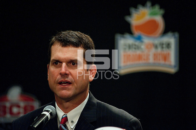 FORT LAUDERDALE, FL--Coach Jim Harbaugh answers questions from the media during the Head Coaches Press Conference at the Marriott Harbor Beach in Fort Lauderdale, Florida.