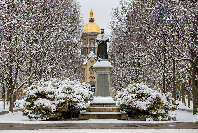 February 13, 2020; The Sorin statue and Main Building after a snowfall. (Photo by Barbara Johnston/University of Notre Dame)