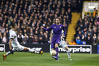 Federico Bernardeschi of Fiorentina plays a pass as Erik Lamela of Tottenham Hotspur slides in during the UEFA Europa League 2nd leg match between Tottenham Hotspur and Fiorentina at White Hart Lane, London, England on 25 February 2016. Photo by Andy Rowland / Prime Media images.