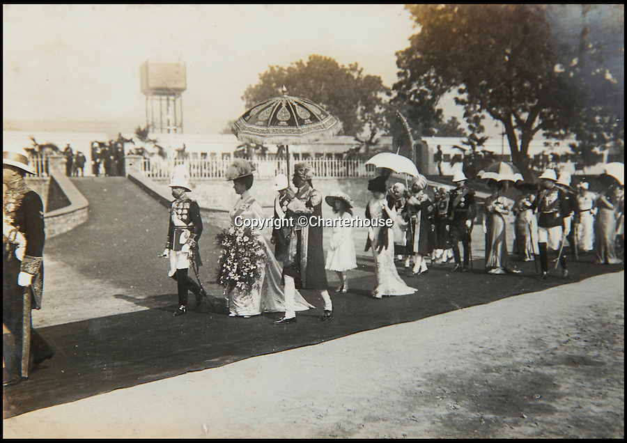 BNPS.co.uk (01202 558833)<br /> Pic: Charterhouse/BNPS<br /> <br /> King George V and Queen Mary at the Delhi Durbar in 1911 commemorate their coronation as Emperor and Empress of India.<br /> <br /> Candid photographs showing King George V getting carried away on holiday - during an hilarious four-legged race on board the Royal Yacht - have come to light.<br /> <br /> One snap shows the current Queen's grandfather being dragged off his bound feet by his own footman in the farcical event in 1911.<br /> <br /> The pictures are being sold by the family of former footman Ernest Brown at auction in Sherborne, Dorset,