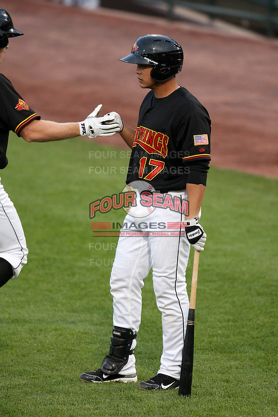 Rochester Red Wings Catcher Jose Morales greets Dustin Martin after a home run during a game vs. the Columbus Clippers at Frontier Field in Rochester, New York;  June 21, 2010.   Rochester defeated Columbus 2-1.  Photo By Mike Janes/Four Seam Images