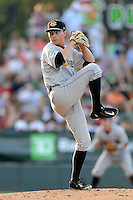 Pitcher Justin Kamplain (26) of the Charleston RiverDogs delivers a pitch in a game against the Greenville Drive on Sunday, May 24, 2015, at Fluor Field at the West End in Greenville, South Carolina. Charleston won 3-2. (Tom Priddy/Four Seam Images)