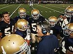Servite @ Notre Dame - Sherman Oaks (CIF Southern Section).Coach Kevin Rooney and team huddle.Notre Dame High School Stadium.Sherman Oaks, CA (Los Angeles) - October 5, 2007.OM3D8185.CREDIT: Dirk Dewachter