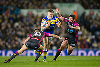 Picture by Allan McKenzie/SWpix.com - 08/02/2018 - Rugby League - Betfred Super League - Leeds Rhinos v Hull KR - Elland Road, Leeds, England - Leeds's Liam Sutcliffe is tackled by Hull KR's Chris Atkin & Chris Clarkson.